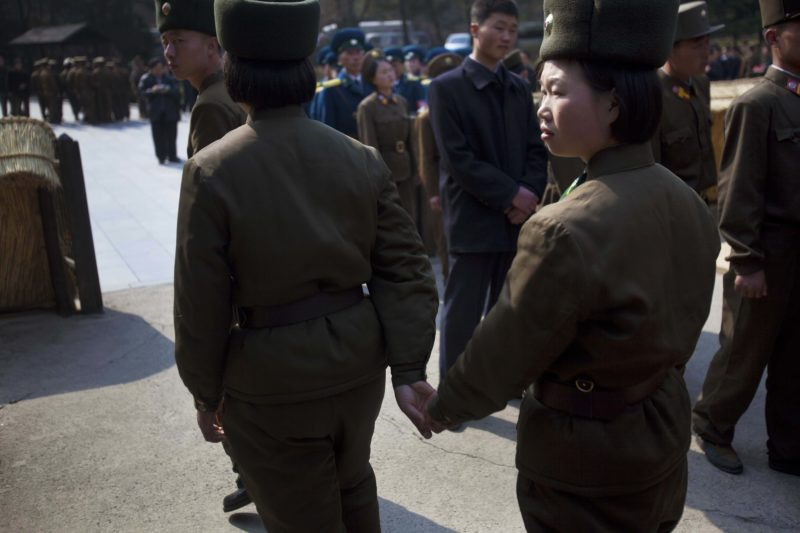 David Guttenfelder – Two female North Korean soldiers hold hands as they tour the birthplace of Kim Il Sung at Mangyongdae, North Korea