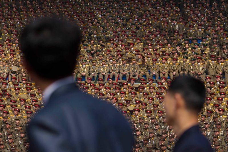 David Guttenfelder - April 15, 2012. Two North Korean officials look up at a crowd of military members seated in a stadium in Pyongyang during a mass meeting called by the Central Committee of North Korea's ruling party