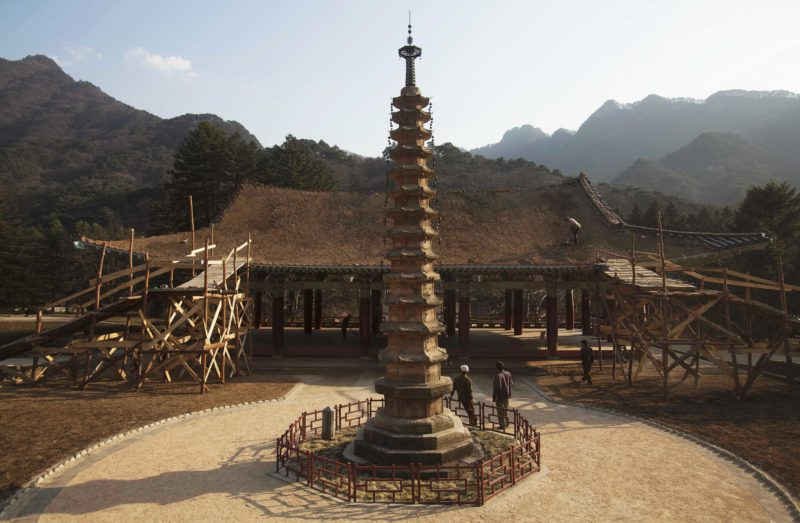 David Guttenfelder - In this April 19, 2011 photo, North Korean workers rebuild the roof of a structure at the Pohyon Temple at the foot of Mount Myohyang, North Korea