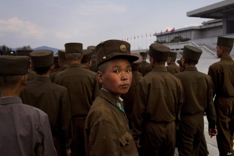 David Guttenfelder - North Korean soldiers tour the park surrounding Kumsusan Palace of the Sun, the mausoleum where the bodies of the late leaders Kim Il Sung and Kim Jong Il lie embalmed, in Pyongyang, April 25, 2013