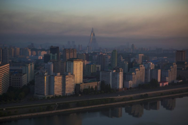David Guttenfelder - Pyongyang at dawn from across the Taedong River. Towering above the city is the 105-story Ryugyong Hotel, under construction since 1987
