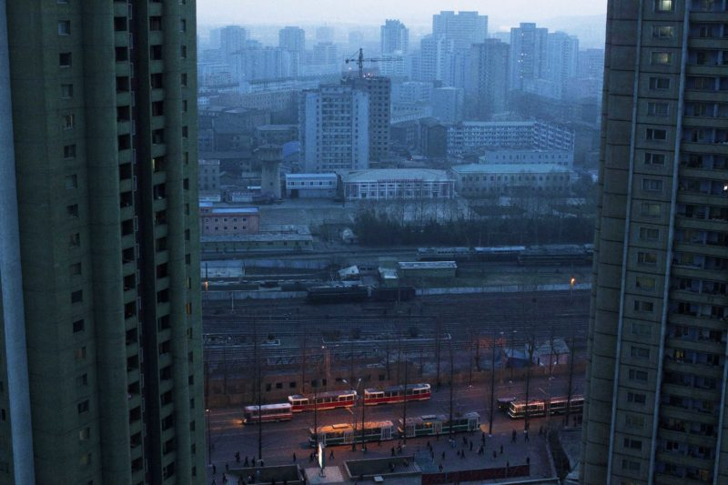 David Guttenfelder - This April 12, 2011 photo shows central Pyongyang, North Korea at dusk through a hotel room window