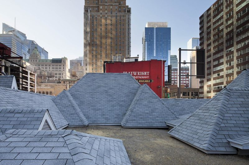 David Brooks - Desert Rooftops, 2011–12, asphalt shingled rooftops, wood, vinyl siding, metal interpretive signs, 16 x 92 x 54 feet, Times Square, New York, November 2011–February 2012.