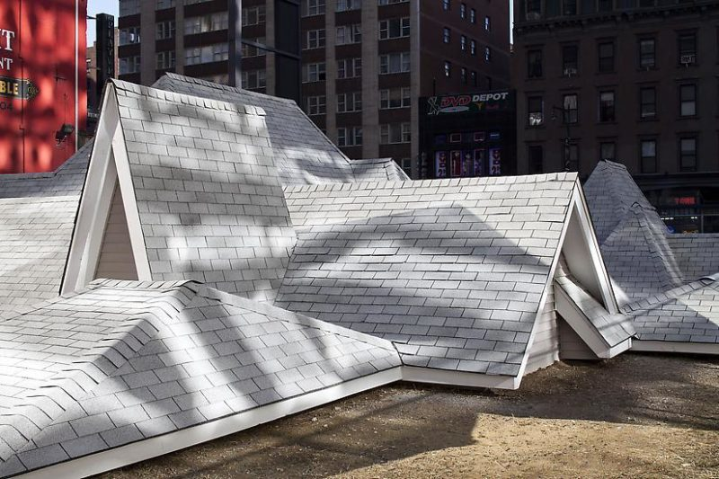 David Brooks - Desert Rooftops, 2011–12, asphalt shingled rooftops, wood, vinyl siding, metal interpretive signs, 16 x 92 x 54 feet, Times Square, New York, November 2011–February 2012