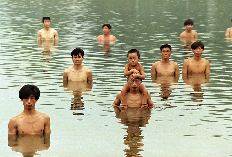 Zhang Huan - To Raise the Water Level in a Fishpond, 1997, 6 min 9 sec, Beijing, China