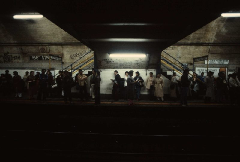 Christopher Morris - Commuters wait for a train at 168th Street station in Manhattan, 1981