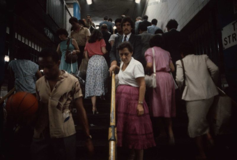 Christopher Morris - Commuters ascend and descend stairwells during rush hour, 1981