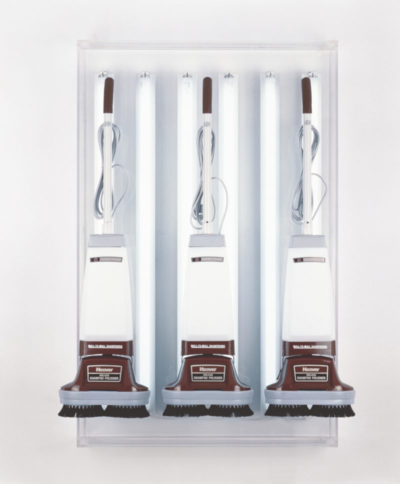 Jeff Koons - New Hoover Deluxe Shampoo Polishers, 1980-1986, three shampoo polishers, acrylic, fluorescent lights, 142.2 x 91.4 x 38.1 cm