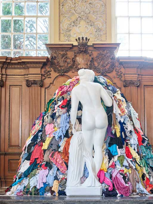 Michelangelo Pistoletto's nude Venus inspects a rag of clothes (sfw)