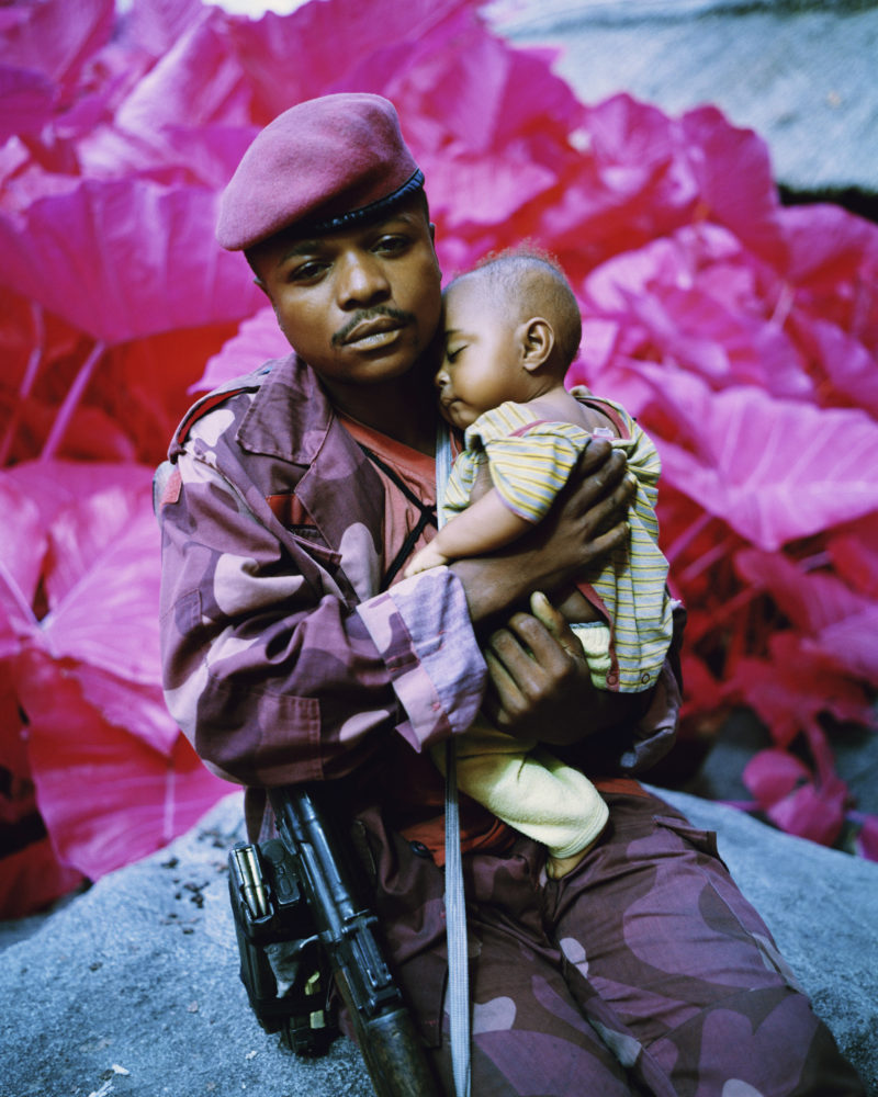 Richard Mosse - Madonna and Child, North Kivu, Eastern Congo, 2012 Digital C print, 35 x 28 inches. Courtesy of Jack Shainman Gallery