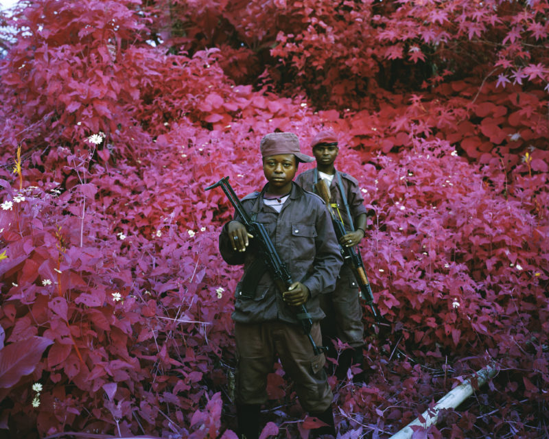 Richard Mosse - Two Soldiers- Man-Size, North Kivu, eastern Congo, 2011 Digital C print, 72 x 90 inches, Courtesy of the artist and Jack Shainman Gallery