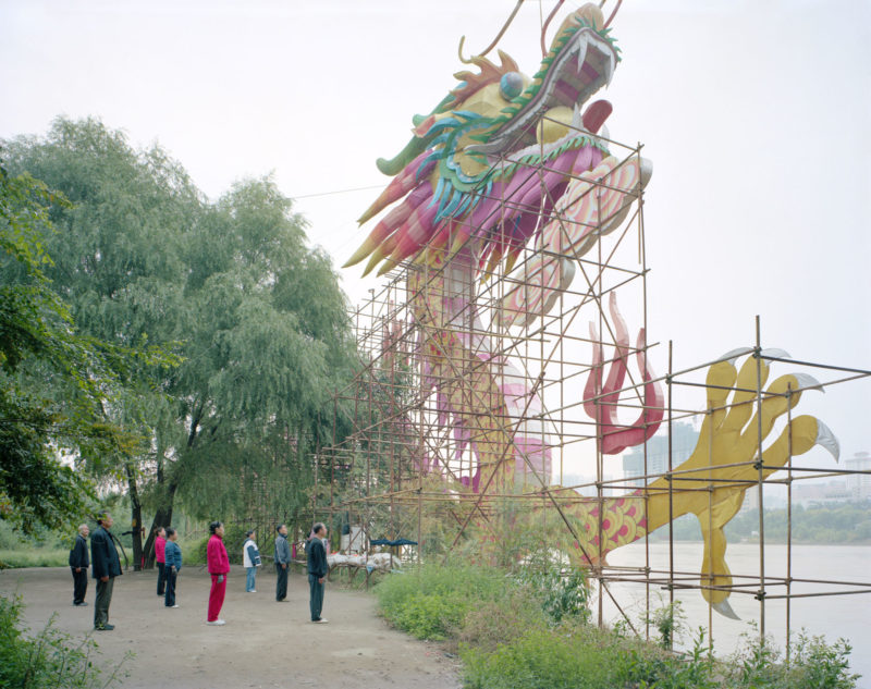 Zhang Kechun - People Doing Morning Excercise under a Dragon Lamp, Gansu, 2011 Archival Pigment Print, 90.2x109.2 cm