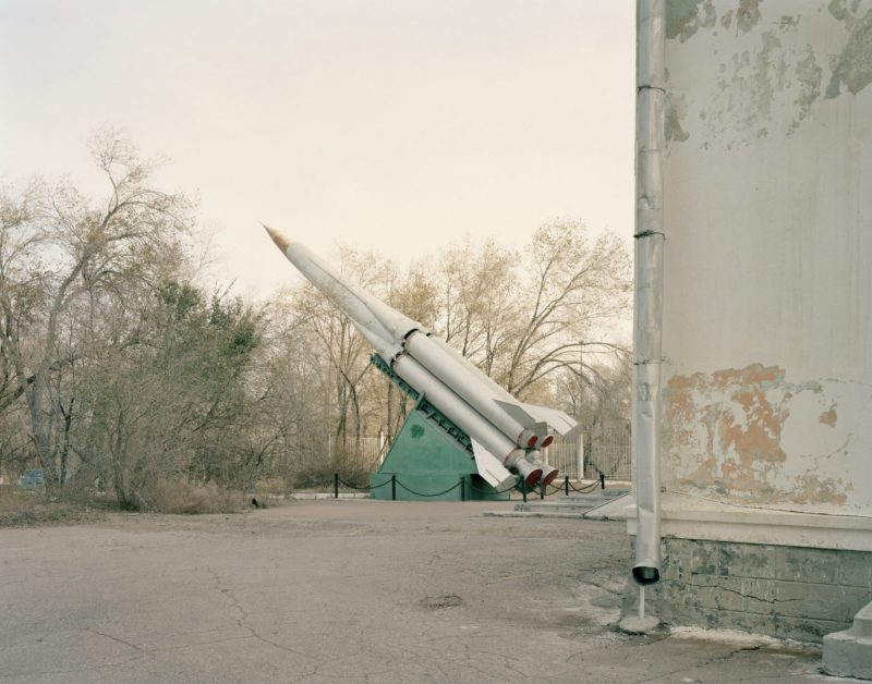 Nadav Kander - Priozersk IX (missile on display beside the military house of culture), Kazakhstan, 2011