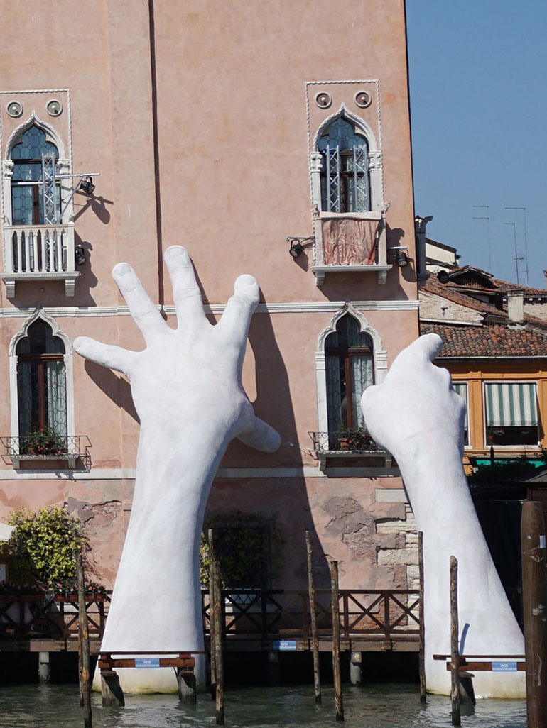 Lorenzo Quinn's giant hands sculpture in Venice