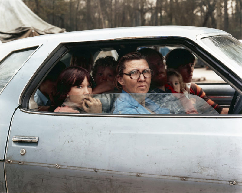 Joel Sternfeld - American Prospects, Family in a car in tent city, outside of Houston, Texas, January 1983