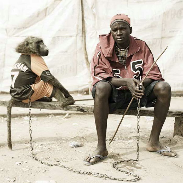 Pieter Hugo - Abdullahi Galadima with the monkey Amiloo, Nigeria 2005
