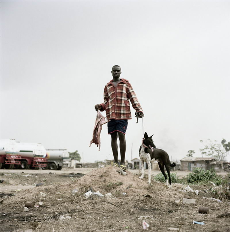 Pieter Hugo - Abdullahi Mohammed with wild dog and antelope carcass, Ogere-Remo, Nigeria 2007