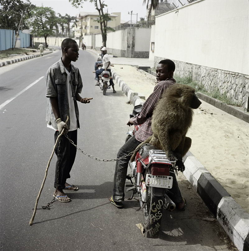 Pieter Hugo - Handler with School Boy, Lagos, Nigeria 2007