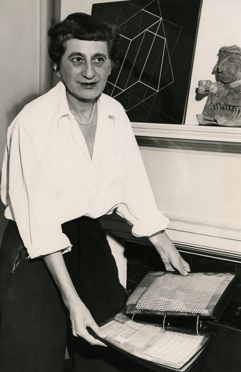 Anni Albers with textile samples in her home in New Haven, Connecticut, ca. 1950
