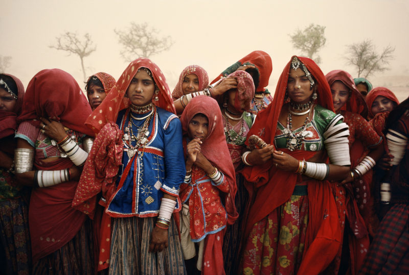 Steve McCurry - Cluster of women during a dust storm, Rajasthan, India, 1983