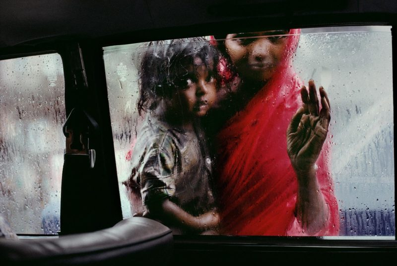 Steve McCurry - Mother and Child at Car Window, Bombay:Mumbai, India, 1993