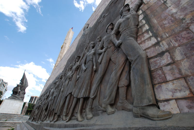 There is one relief on each side, featuring the triumphant onward march of the workers. The other one shows both the former emperor Haile Selassie and Colonel Mengistu of the Derg, which overthrew him. Tiglachin Monument, 1984 – Addis Ababa, Ethiopia