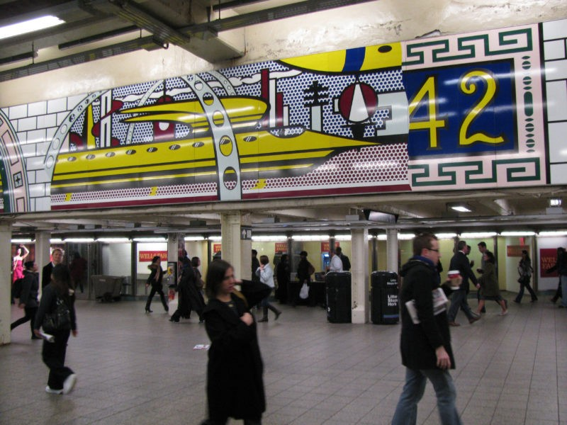 Roy Lichtenstein – Times Square Mural, 1990 (fabricated 1994; installed 2002), Porcelain enamel on steel, 16 panels, 1.85 x 16.26 m (overall), 73 x 640 1/2 inches, NYCT Times Square, 42nd Street Station, New York City