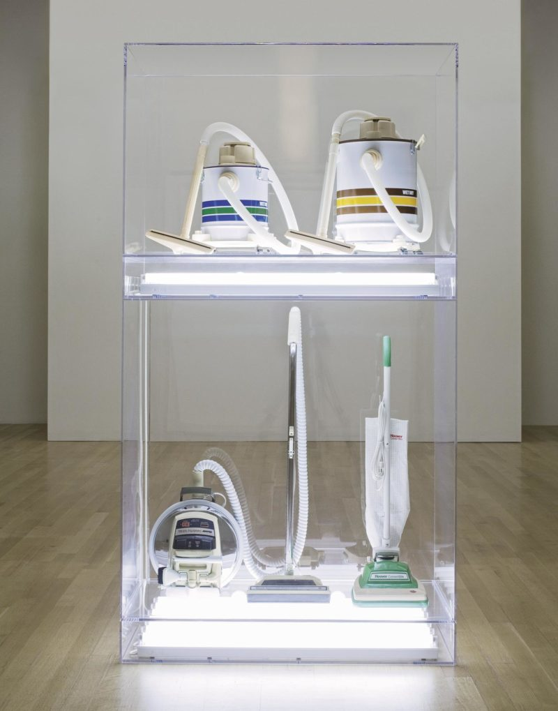 Jeff Koons - The New - New Hoover Celebrity Iv, New Hoover Convertible, New Shelton 5 Gallon Wet/Dry, New Shelton 10 Gallon Wet/Dry Doubledecker, 1986, Four vacuum cleaners, acrylic, fluorescent lights, 251.5 x 135.9 x 71.1 cm