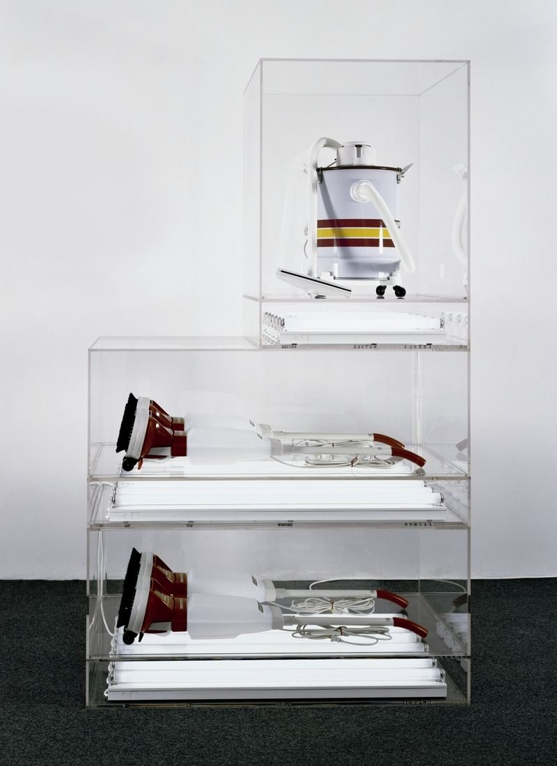 Jeff Koons - The New - New Hoover Deluxe Shampoo Polishers, New Shelton Wet/Dry 10-gallon Displaced Tripledecker, 1981-87, Shampoo polishers, vacuum cleaner, Plexiglas, and fluorescent tubes, 231.1 × 137.2 × 71.1 cm