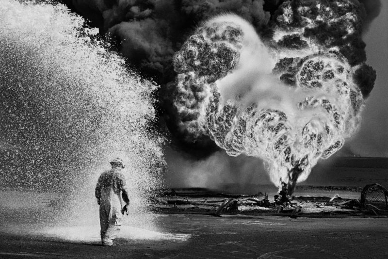 Sebastião Salgado – Greater Burhan Oil Field, Kuwait, 1991 Chemical spray protects firefighter