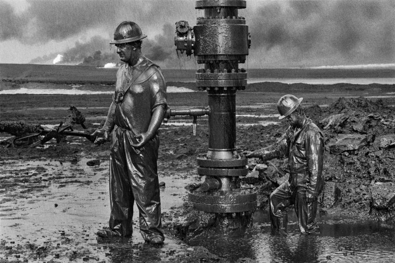 Sebastiao Salgado – Greater Burhan Oil Field, Kuwait, 1991, Workers place a new wellhead in an oil well that had been damaged by Iraqi explosives