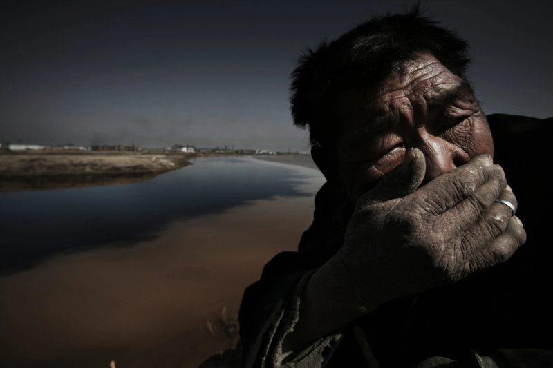 Lu Guang - A sheepherder on the bank of the Yellow River. Shizuishan City, Ningxia, April 23, 2006