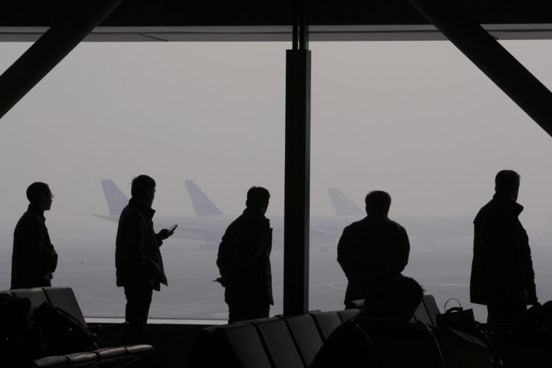 Lu Guang - Severe haze occurred in Capital International Airport. Passengers are waiting in the airport lounge