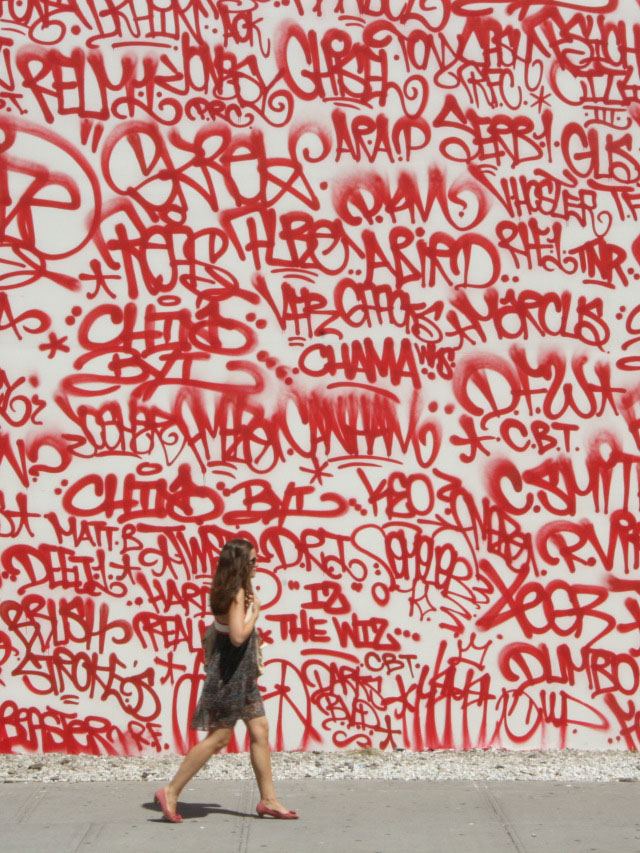 Walls covered with hundreds of red tags - Barry McGee