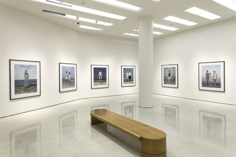 Installation view of the Beach Portraits (1992-2002), from the exhibition Rineke Dijkstra – A Retrospective, Solomon R. Guggenheim Museum, New York, June 29 – October 8, 2012