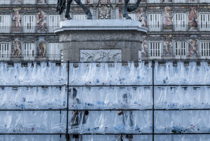 Luzinterruptus - Labyrinth of plastic waste, 2017, 15000 discarded water bottles, bags, metal, lights, 300 m2, 3m tall walls, Plaza Mayor, Madrid, Spain
