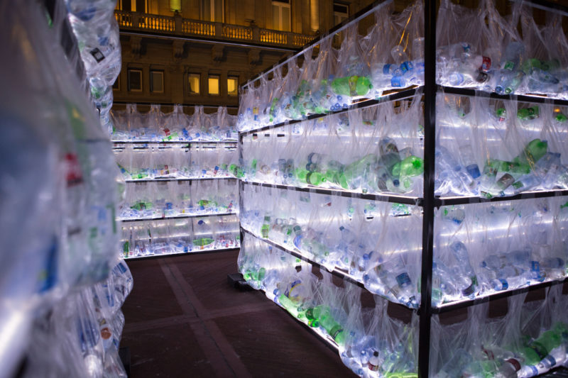Luzinterruptus - Labyrinth of plastic waste, 2018, 15000 discarded water bottles, bags, metal, lights, 12 x 12 m, Plaza Vaticano, Buenos Aires, Argentina