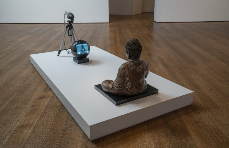 Nam June Paik - TV Buddha (Bronze Seated Buddha), 2004, Video installation with closed circuit camera, black and white JVC television, and bronze Buddha statue with permanent oil marker, 55 × 50.8 × 40.6 cm (21 11/16 × 20 × 16 in.)