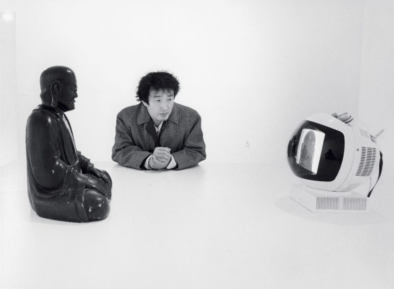 Nam June Paik and his Buddha TV 1974, pictured at Projects - Nam June Paik, Museum of Modern Art, New York, 1977, Eric Kroll