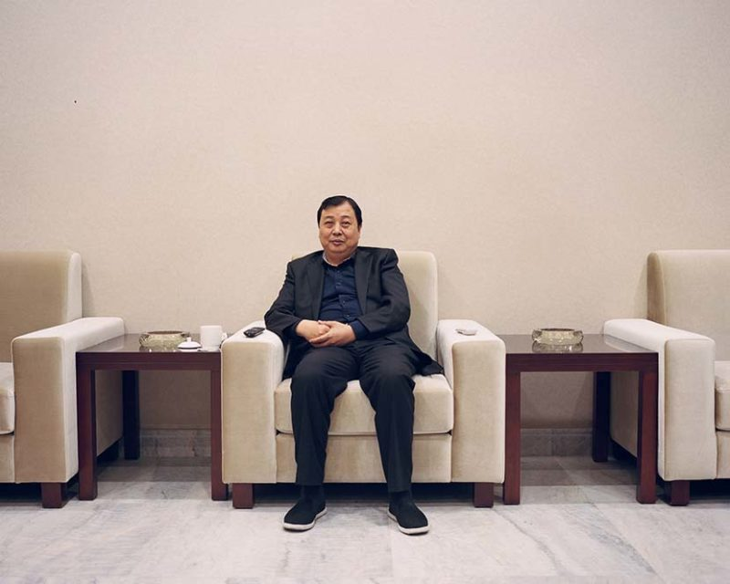Shi Yangkun - Huaxi's Party secretary Wu Xie'en poses for a photo at a meeting room in Huaxi, Jiangsu province, 2018