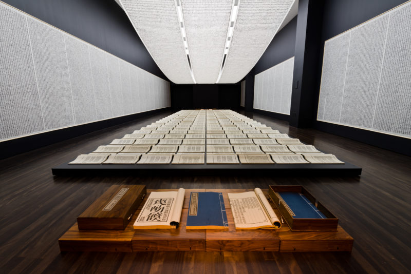 Xu Bing - Book from the Sky, 1987-1991, installation of hand-printed books and ceiling and wall scrolls printed from wood letterpress type, ink on paper, dimensions variable, Installation view at the Blanton Museum of Art, 2016, photo Colin Doyle