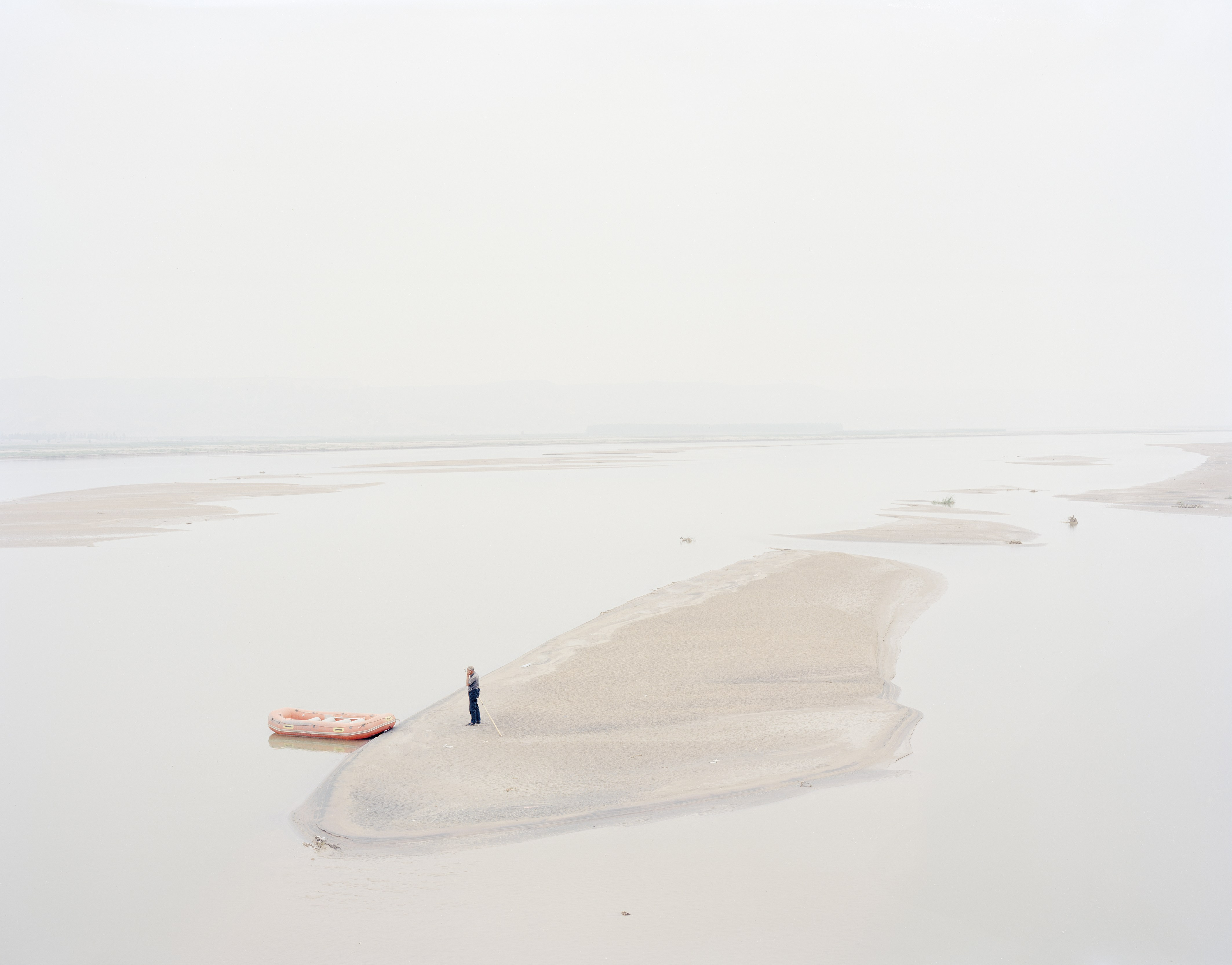 Zhang Kechun – A Man Standing on an Island in the Middle of the River, Shaanxi, China, 2012