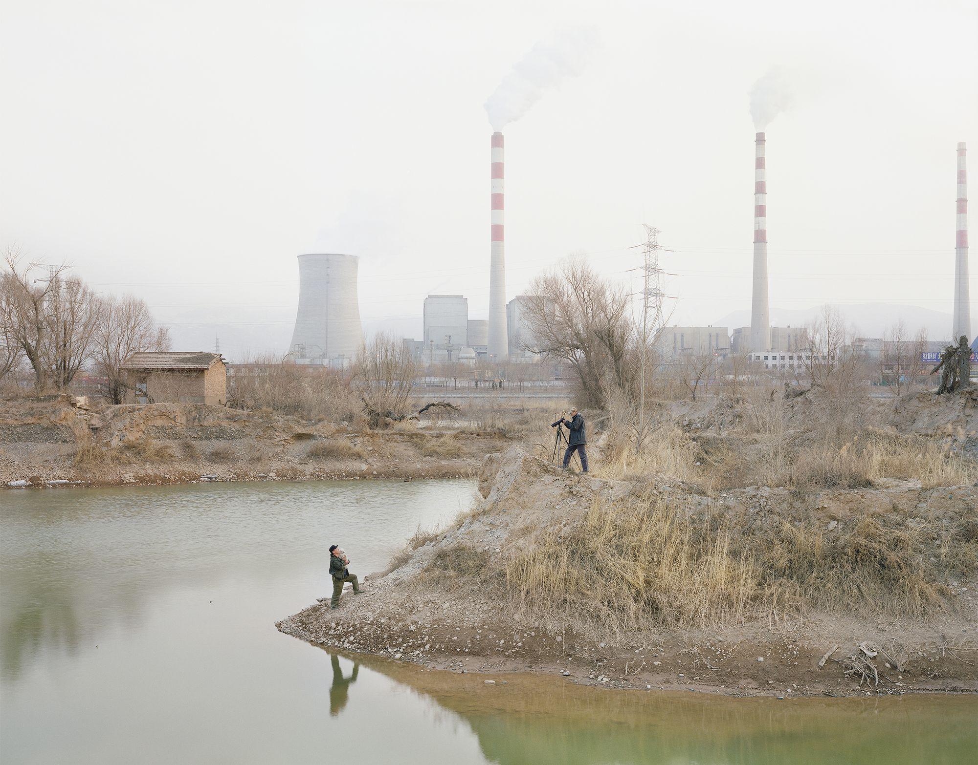 Zhang Kechun – A man photographing by the river, Gansu province