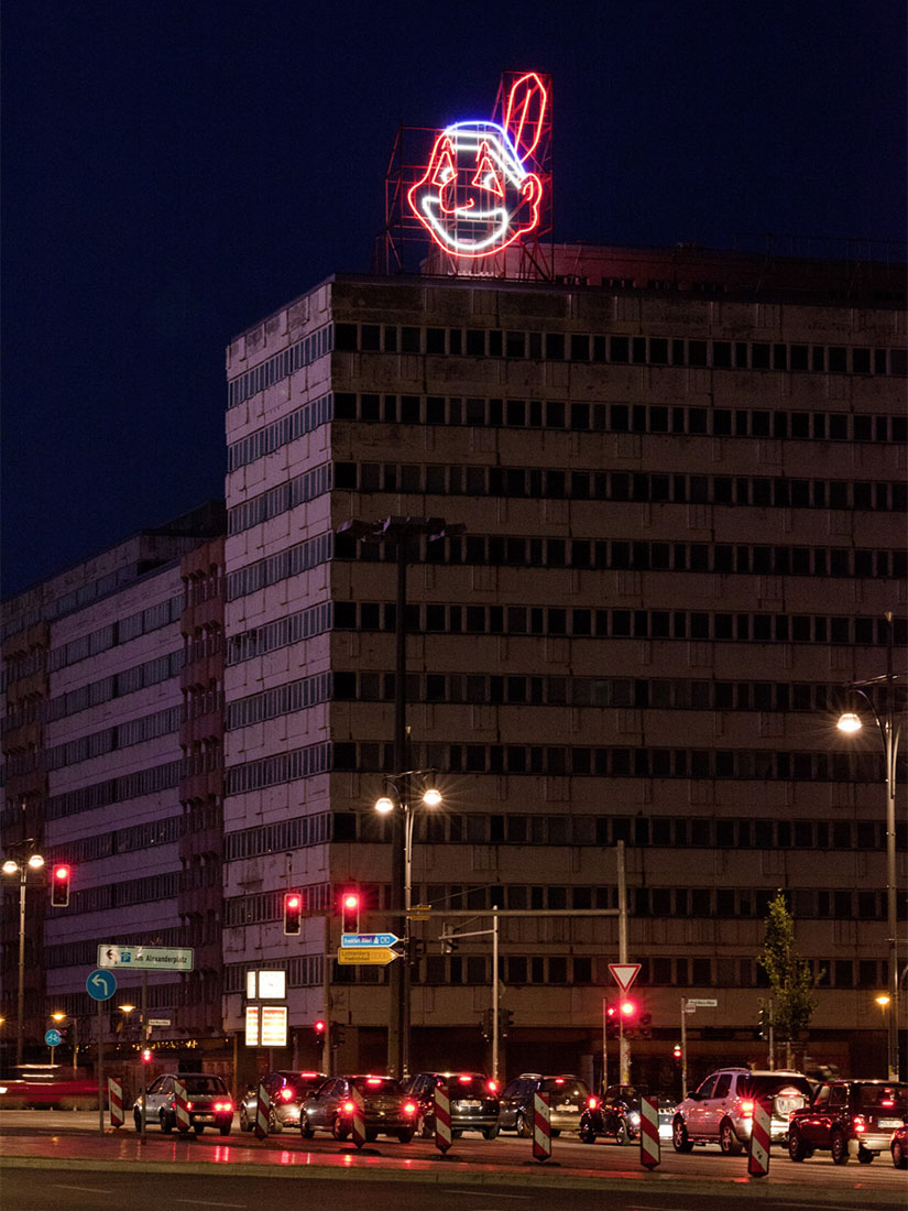 Massive neon sculpture of Indian overlooks Berlin