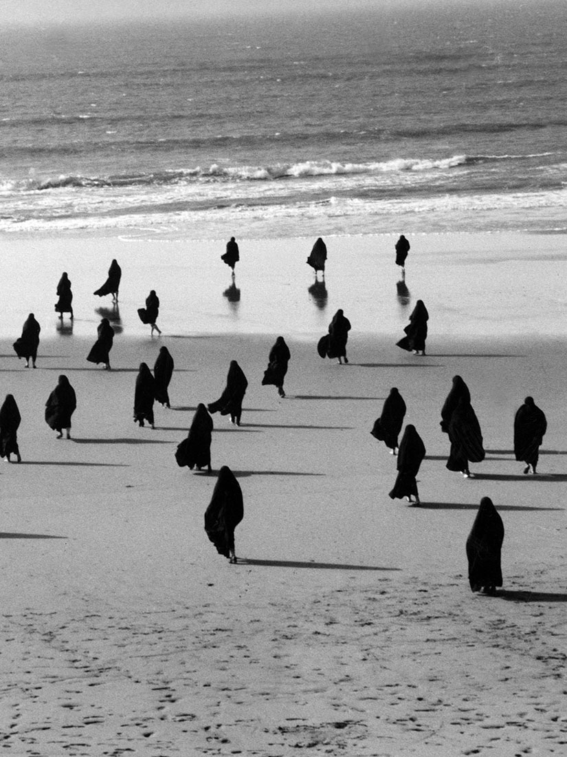 Veiled women in their traditional Islamic attire - Shirin Neshat