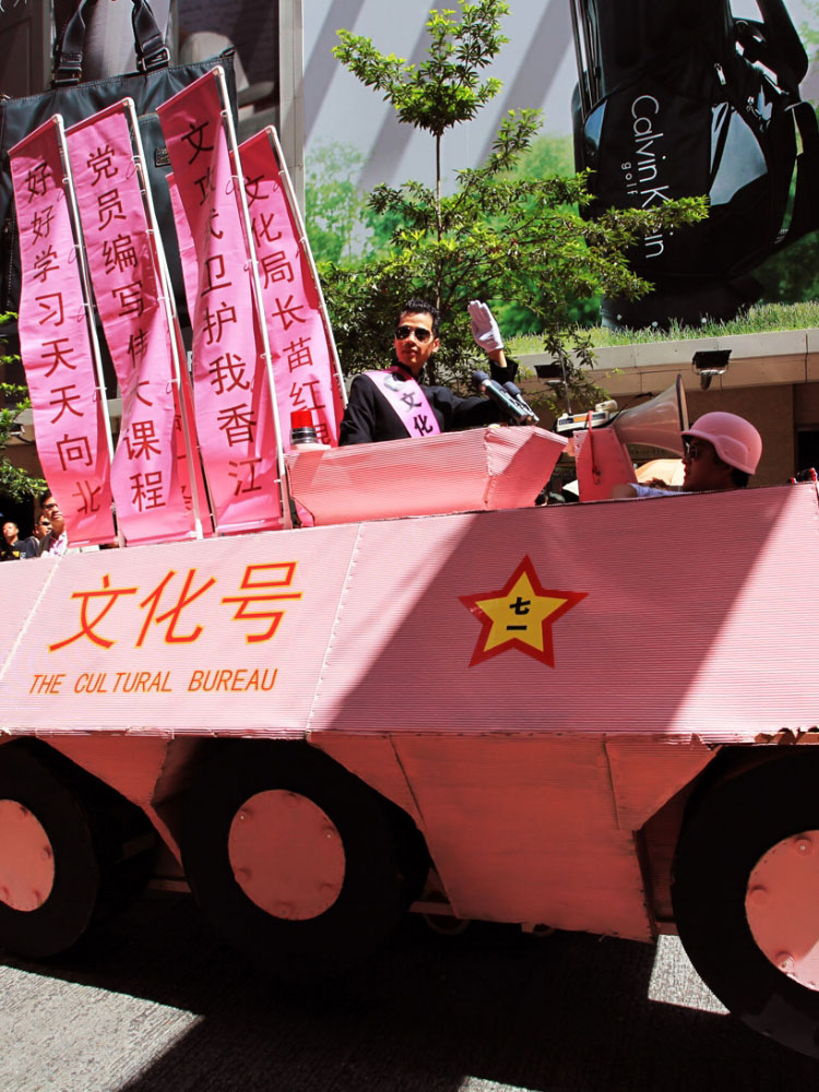 Kacey Wong & his provocative pink tank at Hong Kong's 1 July marches