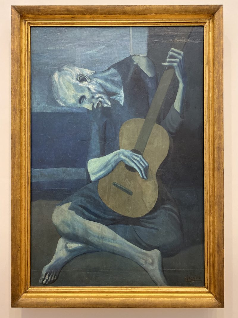 Pablo Picasso – The Old Guitarist, 1903–1904, oil on panel, 122.9 x 82.6 cm (48 3:8 x 32 1:2 in.)