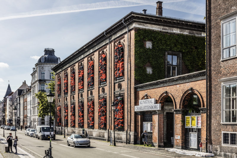 Ai Weiwei - Soleil Levant, 2017, life jackets in front of windows of facade, Kunsthal Charlottenborg, 2017, Anders Sune Berg