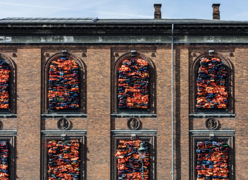 Ai Weiwei - Soleil Levant, 2017, life jackets in front of windows of facade, Kunsthal Charlottenborg, 2017, Anders Sune Berg.