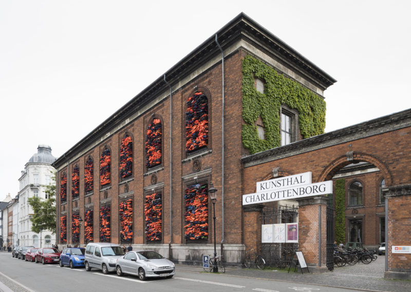 Ai Weiwei - Soleil Levant, 2017, life jackets in front of windows of facade, Kunsthal Charlottenborg, 2017, David Stjernholm